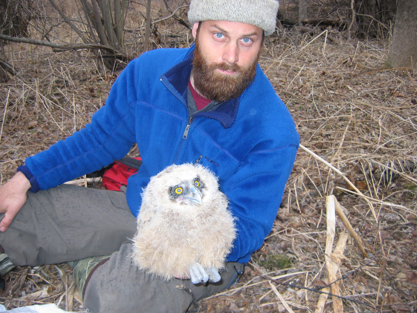 Jonathan Slaght, one of the study's co-authors, holding an owl chick. Photo: Sergei Surmach.